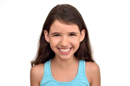 Portrait of a smiling cute young girl with long hair isolated on the white background 写真素材