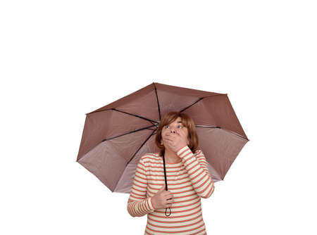 Surprised woman holding an umbrella covering her mouth with a hand and looking up. Isolated on  white background Stok Fotoğraf
