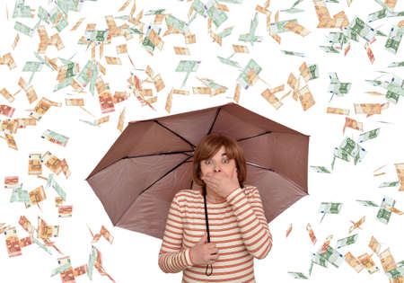 Excited and surprised woman holding an umbrella covering her mouth with a hand while euro banknotes are falling down. Currency, lottery and success concept.