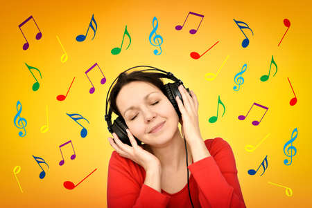 Smiling happy woman with headphones and closed eyes listening to music surrounded by colorful musical notes