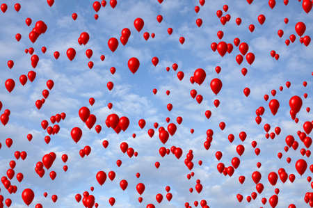 Red balloons flying in the beautiful blue sky