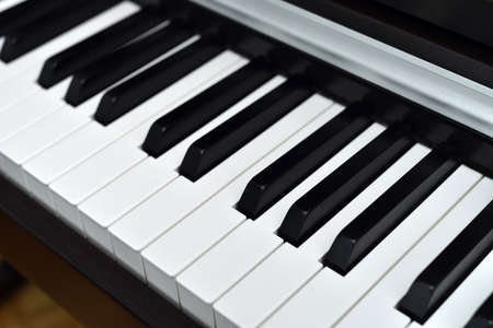 Piano keyboard with black and white keys. Closeup. Selective focus. Zdjęcie Seryjne