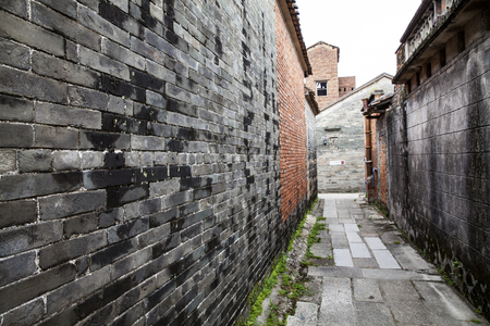 back alley: Back alley of an ancient town with brick wall