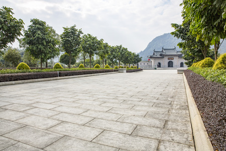 Stone slab road and traditional architecture . Editorial