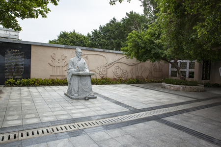 riverside trees: statues and history on the wall