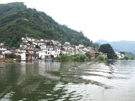 upstream: Nature scenery view with river and buildings Stock Photo