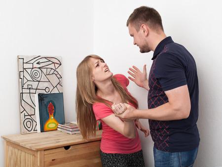 muscle shirt: a man beats a woman, dysfunctional family