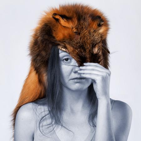 woman with a fox pelt on the head Stock Photo