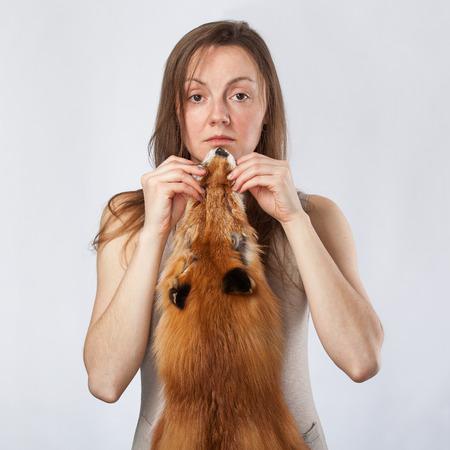 peltry: yong lady carrying fox pelt