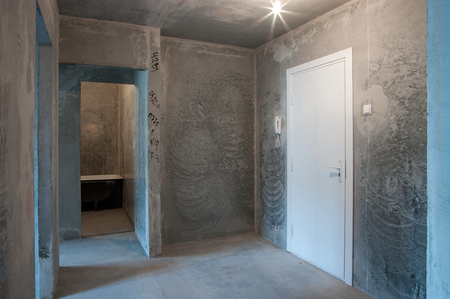 interior in a new apartment without repair with white door