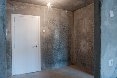 remount: interior in a new apartment without repair with white door
