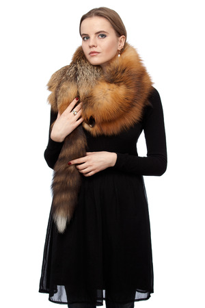 pelt: Young beautiful woman in black dress with a fox collar