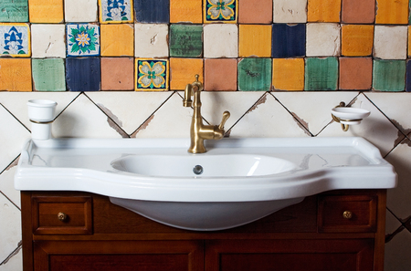 bathroom tile: Close up bathroom sink with bright tile Stock Photo