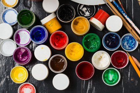 pensils: Art and creativity. Different  colors in the banks, pensils and brushes  on the floor.