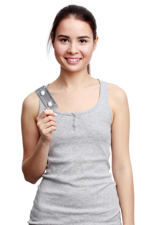 meds: Young smiling woman holding meds in the hands, isolated on white background