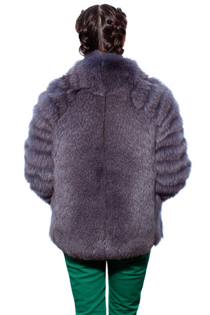 arctic fox: Fashion. The back of a woman in a violet fur coat made of arctic fox and green pants isolated on white background