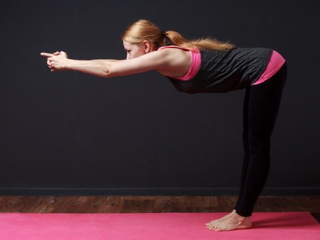 prana: Fitness. Yoga. Young blonde woman doing yoga exercise
