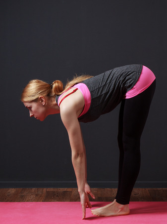 moksha: Fitness. Yoga. Young blonde woman doing slope to the toes