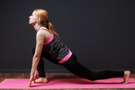 prana: Fitness. Yoga. Forward lunge. Young blonde woman doing yoga exercise
