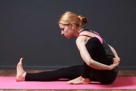 prana: Yoga. Pilates. Stretching. Young blonde woman doing yoga exercise Stock Photo