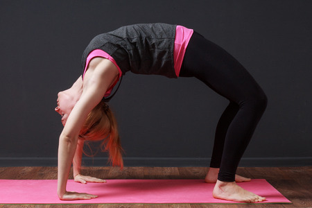 prana: Yoga. Young blonde woman staying in bridge pose