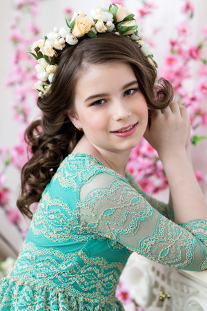 dinky: Close up portrait of a cute smiling  girl in a flower wreath Stock Photo