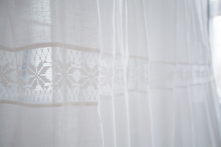 curtain background: Close up soft light white curtains with the hemstitch