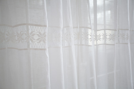 curtain background: Window design. Soft light white curtains with the hemstitch