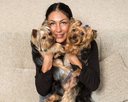 breeder: Pets. Close up  portrait of a woman - yorkshire terrier breeder with dogs
