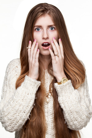 suddenness: Close up portrait of a surprised woman, mouth is opened, white background