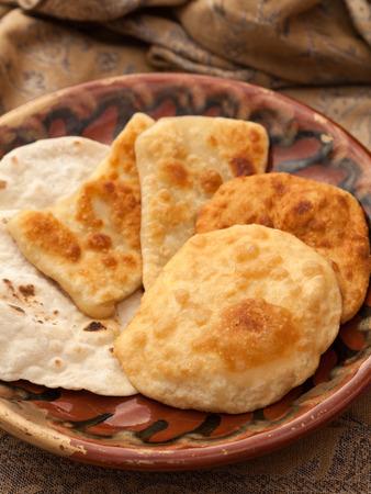 pastil: Food. Bakery. Golden pastils on a plate, brown background