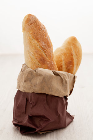 moulding: Food. Two fresh baguettes in a paper package Stock Photo