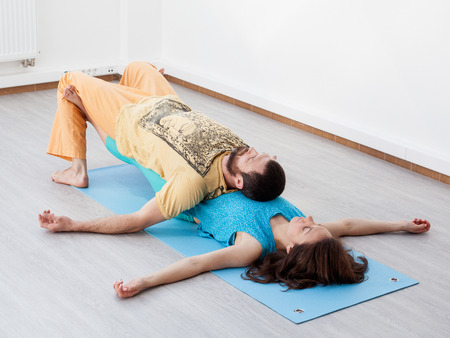 somatic: Pair exercises. Stretching. A man and a woman are performing thai massage