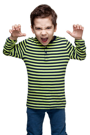 hands lifted up: Children. Expressions. Close up portrait of a  little boy in a striped shirt and jeans, he frightens somebody, hands are menacingly lifted, mouth is opened, white background
