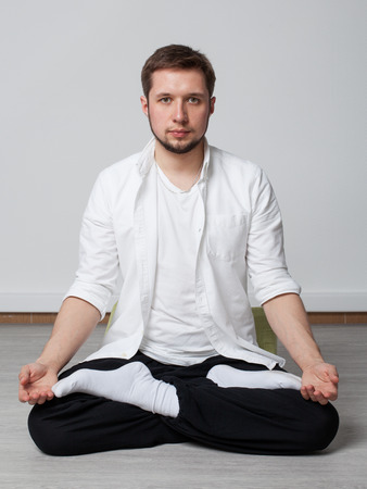 qigong: Qigong. Meditation. Young man in sitting in lotus pose meditating Stock Photo