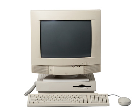 Old computer. The system unit, monitor, keyboard and mouse isolated on white background. Stock Photo