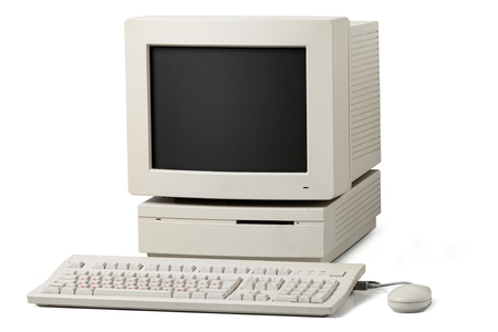 Old personal computer. The system unit, monitor, keyboard and mouse isolated on white background.