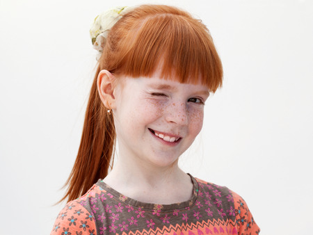 Close up portrait of a ginger girl winking