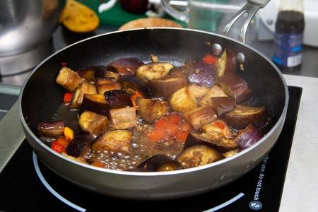 stew pan: Stew eggplants preparing in the pan on the stove
