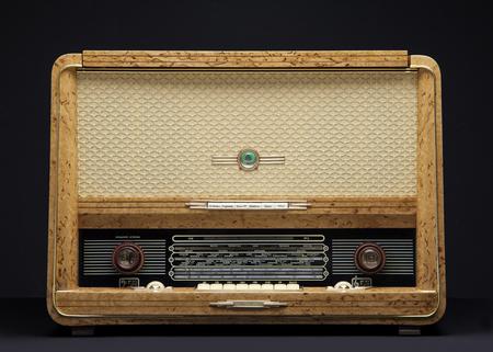 radiogram: Old vintage radio on a dark background