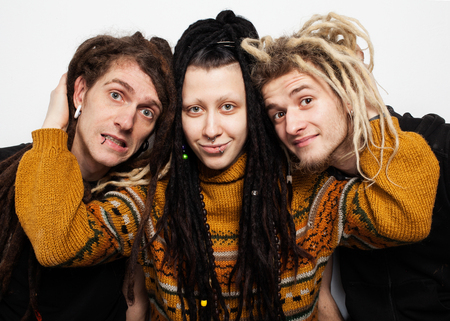 freaky: Cute freaky  girl with dreadlocks and piercings is hugging two boys with dreadlocks and smiling, white background