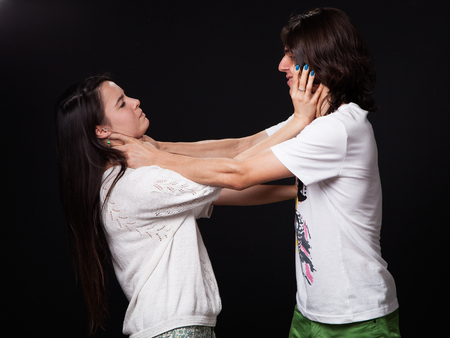 intimidate: Domestic violence - husband  and wife are fighting, black background Stock Photo