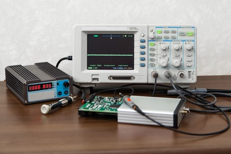 oscilloscope: The oscilloscope for the measurement and control electronic signals on the engineers workplace Stock Photo