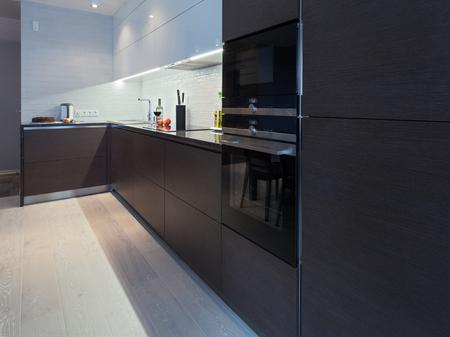 worktops: Design interior of a high tech kitchen with dark cupboard Stock Photo