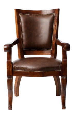 upholstered: Luxurious brown vintage wooden armchair upholstered in leather isolated on white background Stock Photo