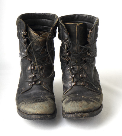 military boots: Black old military boots completely worn out