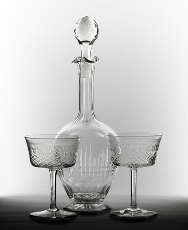 decanter: Two transparent glasses and decanter with a cork