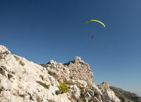 Paraglider visiting ruins of an old castle Stock Photo