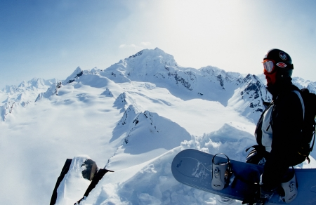 alpine zone: VALDEZ, ALASKA - APRIL 24: Snowboarder Esben Pedersen preparing for descent of a isolated peak in the Chugach Mountains on April, 24, 2002. Valdez is the hub for Heli-skiing in Alaska.