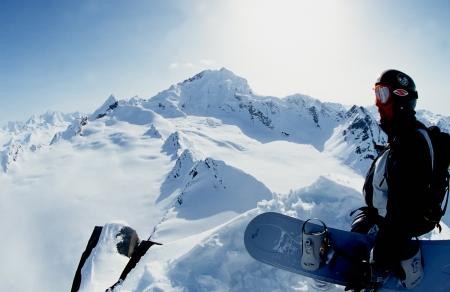 alpine zone: VALDEZ, ALASKA - APRIL 24: Snowboarder Esben Pedersen preparing for descent of a isolated peak in the Chugach Mountains on April, 24, 2002. Valdez is the hub for Heli-skiing in Alaska.